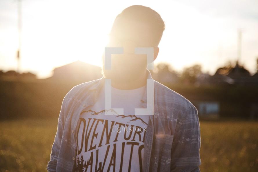 man wearing an Adventure Awaits t-shirt