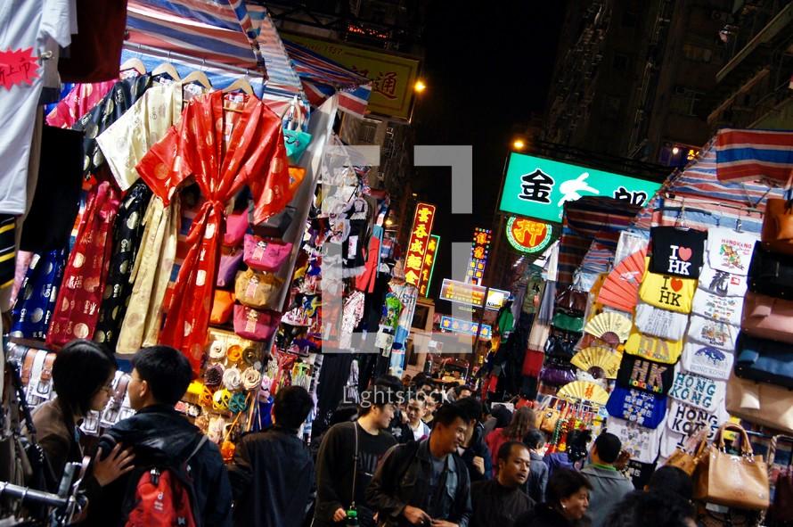 People shopping in a street market in Hong Kong, China at night