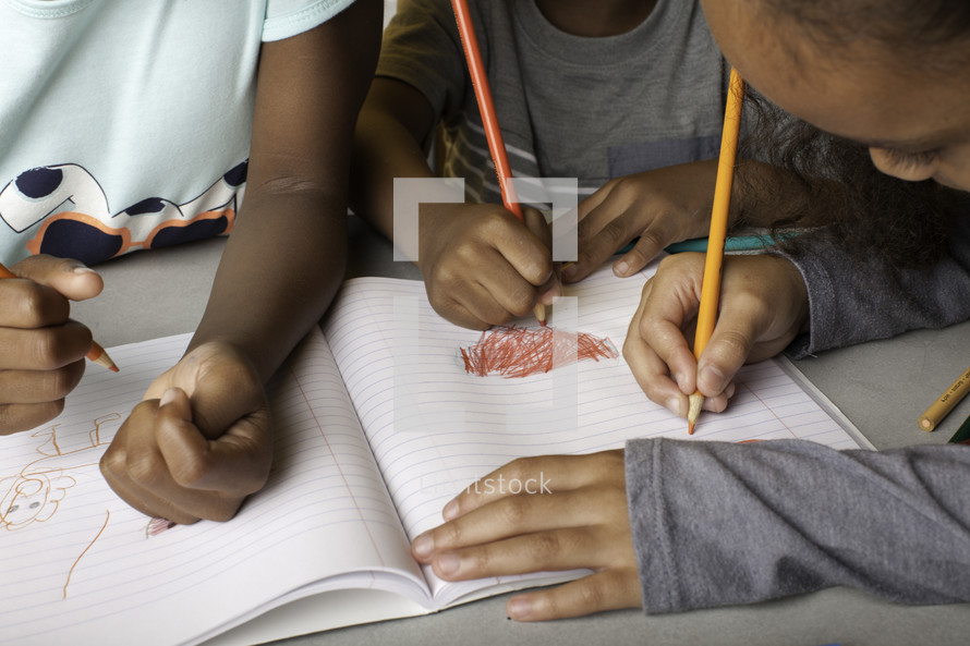 kids coloring on paper