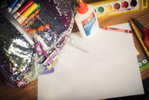 school supplies and blank paper