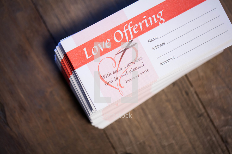 Love offering envelopes stacked