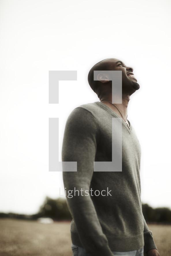 Man looking towards heaven