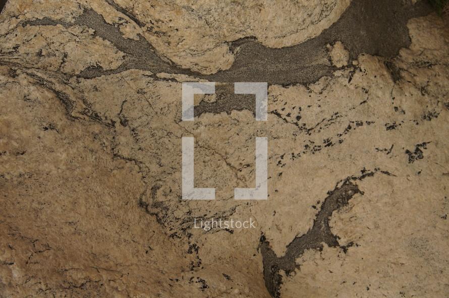 Slab of granite with swirled texture.
