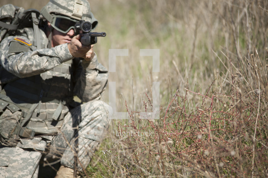 Military man aiming a rifle.
