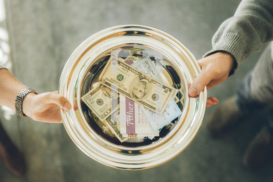 Tithes and offering being passed