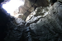 Looking up from a cave