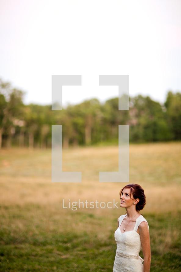 Bride in open grass field