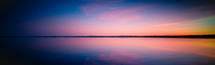 panorama view of a sunset over a lake