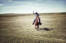 a cowboy with a lasso