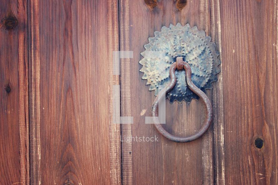 Woden door with metal door knocker.