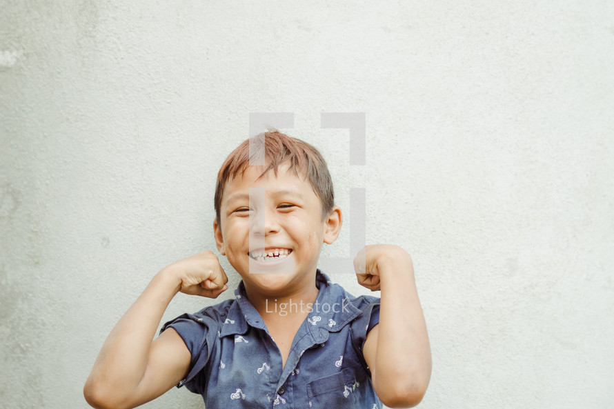 kid showing muscles