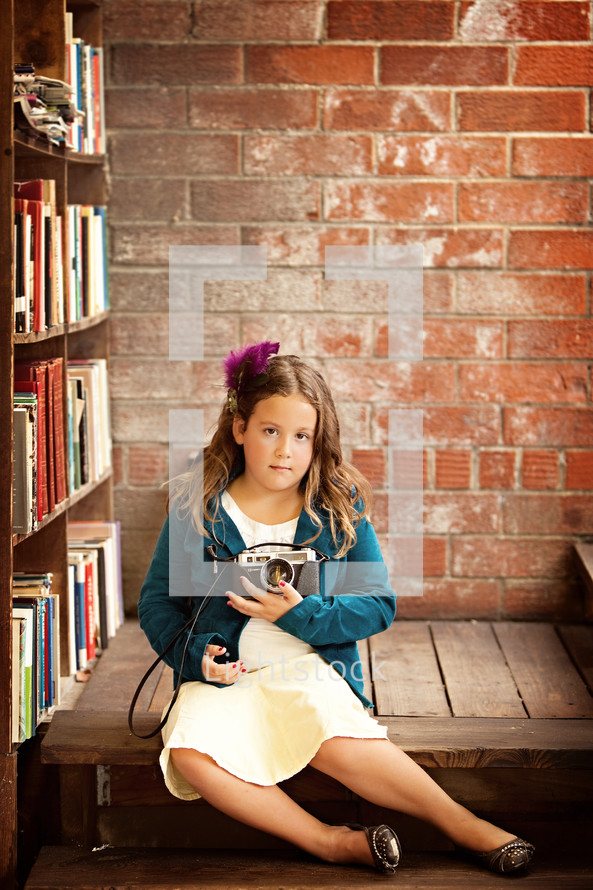 girl child holding a camera