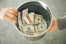 Tithes and offering inside a bucket being passed