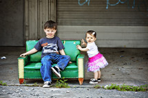 Little boy and girl sitting on a couch