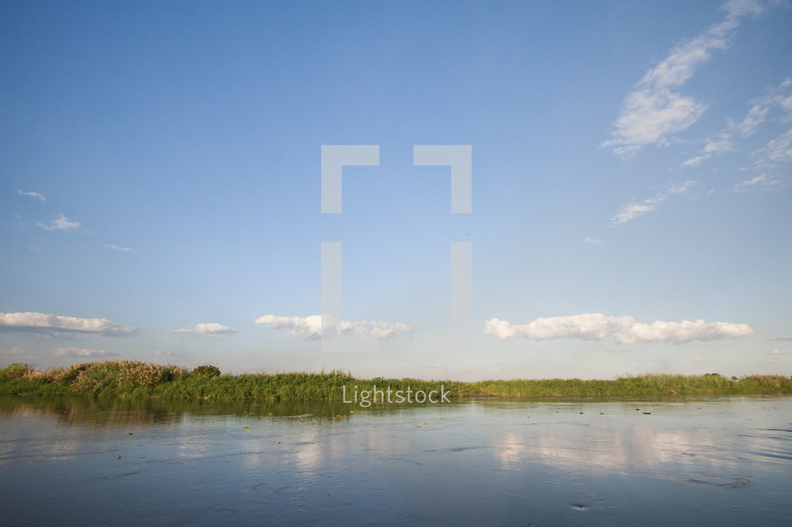 shore of a calm river
