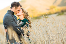 Happy couple kissing in field