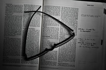 Glasses on study Bible