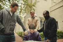 Bible study with men praying