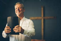 pastor holding a bible during a worship service