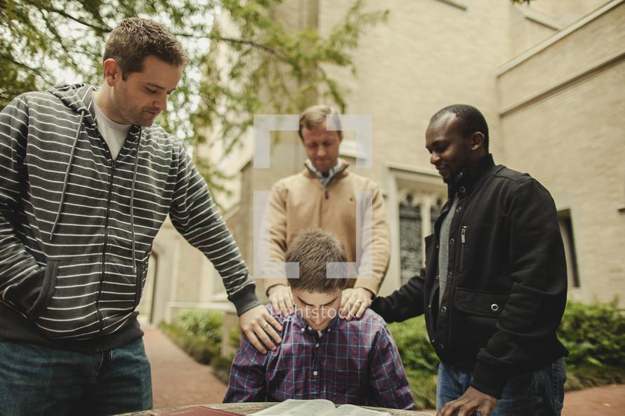 Bible study with men praying