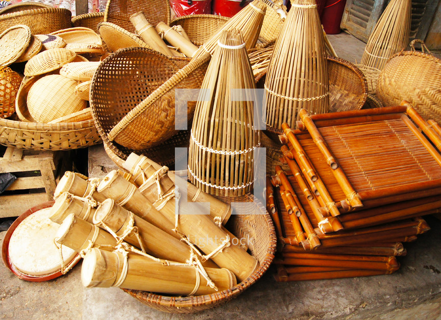 Different types of bamboo, wooden and thatched baskets and containers