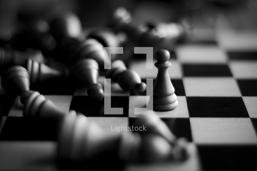 Power of One; one lone chess piece standing while all others have fallen.