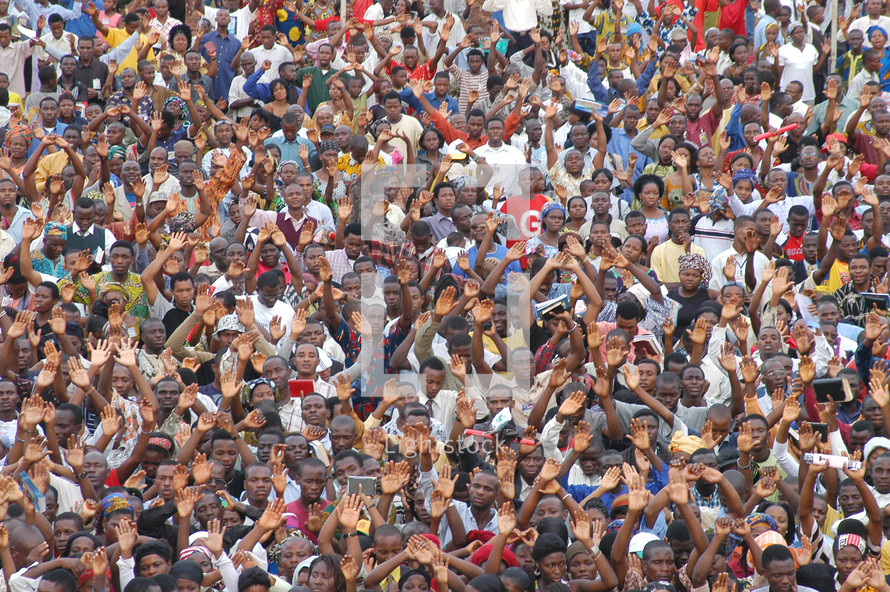 Large crowd worshiping and praising God at a gospel meeting in Africa. Hundreds of thousands, actually the full crowd was in excess of a million, each one a reason why Christ died.