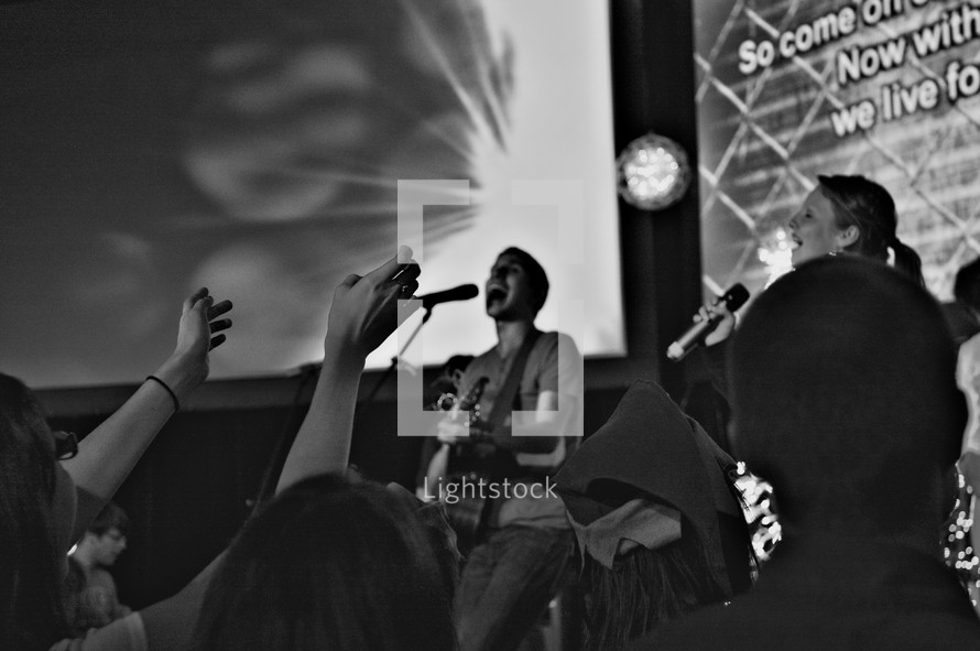 musicians on stage at a contemporary worship service