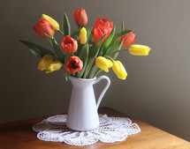tulips in a pitcher vase
