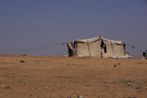 A migrant tent in the desert