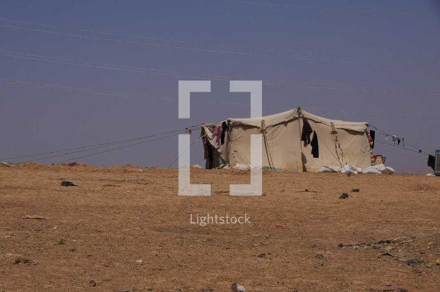 A migrant, refugee or nomadic herdsman tent in the desert