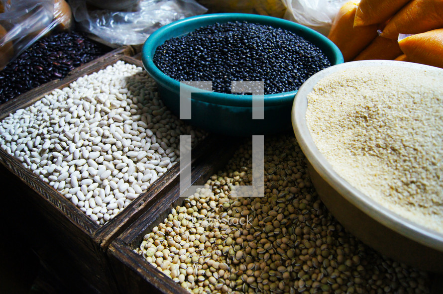 Different types of colored beans at a market