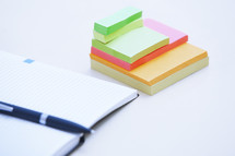 open planner and sticky notes on a desk