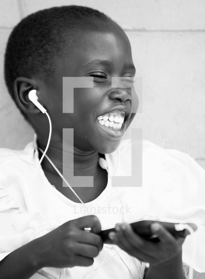 joyful child listening to music on an iPod