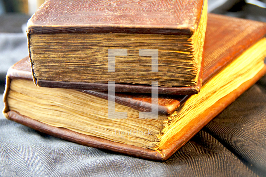 stack of old hand made bibles