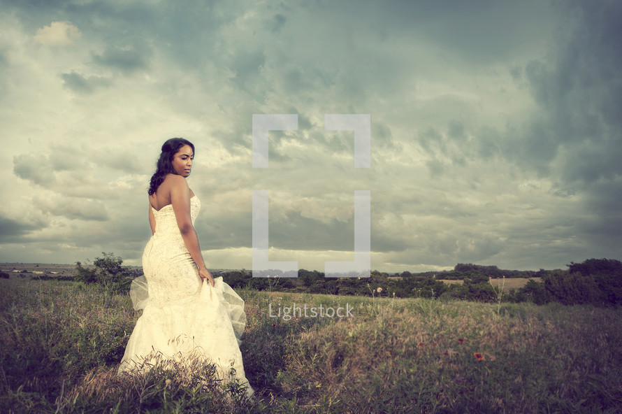 Bride in grass field