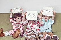 Siblings holding up Easter signs