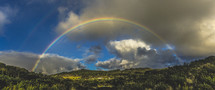rainbow over a valley