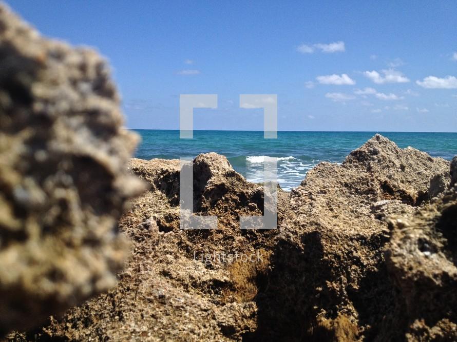 rocks in front of the ocean
