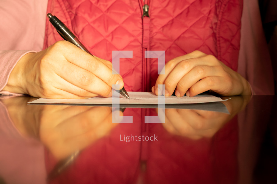 a woman writing a letter
