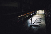 man standing in a warehouse