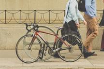 a bicycle locked on a bike rack