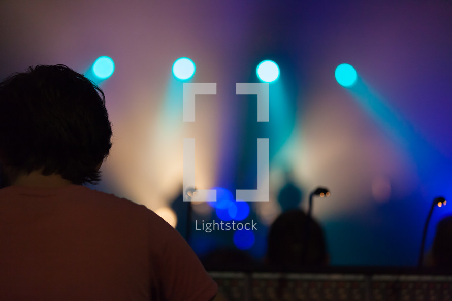 spot lights shining on parishioners
