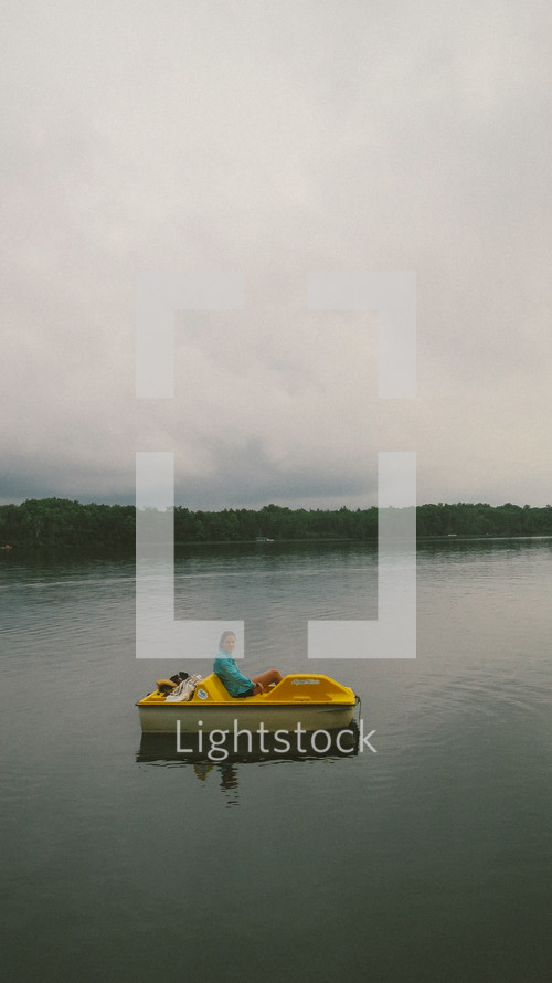 woman in a paddle boat