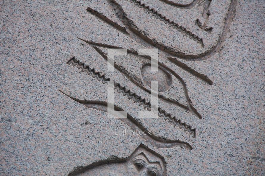 Egyptian hieroglyphics carved into stone