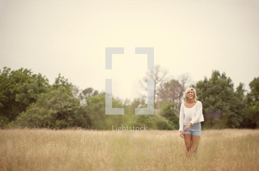 blonde woman in a field