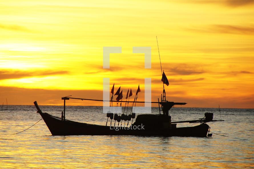 A fishing boat at sunset