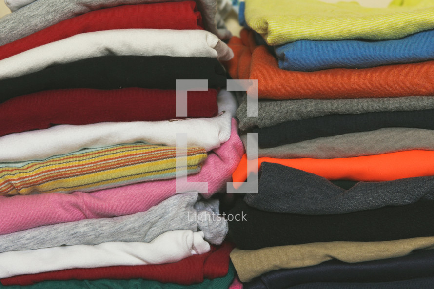 Stacks of folded clothes for boys and girls
