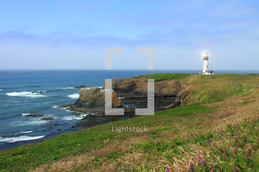 distant lighthouse on a rocky shore