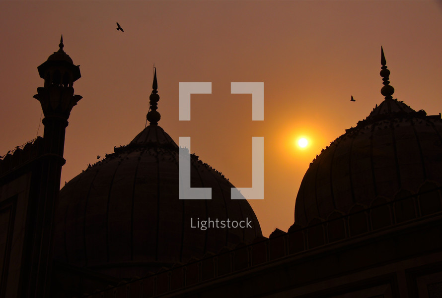Silhouette of a mosque at sunset